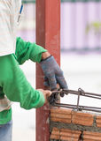 Workers using steel wire and pincers rebar before concrete is po Royalty Free Stock Photography