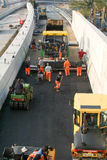 Workers and vehicles during the asphalting of the highway Royalty Free Stock Images