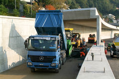 Workers and vehicles during the asphalting of the highway Royalty Free Stock Photos
