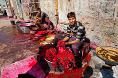 Workers of a village textile factory paint clothing Royalty Free Stock Photography