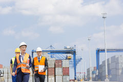Workers walking in shipping yard Royalty Free Stock Image