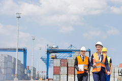 Workers walking in shipping yard Royalty Free Stock Photos