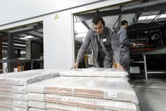 Workers in warehouse depot stock photography
