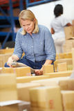 Workers In Warehouse Preparing Goods For Dispatch stock images
