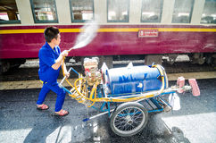 Workers are wash and cleaning up the train. Stock Photo