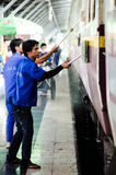 Workers are wash and cleaning up the train. Stock Image