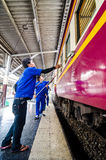 Workers are wash and cleaning up the train. Royalty Free Stock Photo