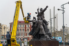 Workers wash the monument. Royalty Free Stock Images