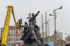 Workers wash the monument. Stock Images