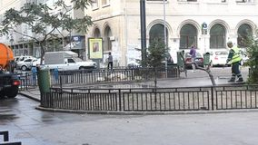 Workers washing sidewalks Stock Image