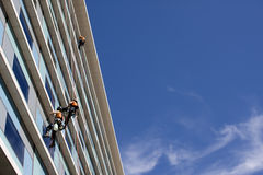 Workers washing the windows facade Stock Photos