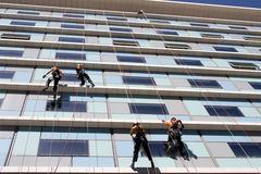 Workers washing the windows facade Royalty Free Stock Photo