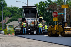 Dumping hot asphalt Stock Photo