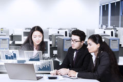 Workers watching financial graph Royalty Free Stock Photo