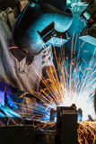 Workers weld car industry Stock Image