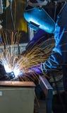 Workers weld steel Stock Image