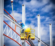 Workers welded steel structures Stock Photos