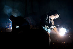 Workers with welding torches stock image