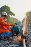 Workers were cutting tracks for maintenance. Workers were cutting tracks  maintenance Royalty Free Stock Image