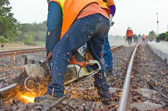 Workers were cutting tracks  maintenance. Stock Photos