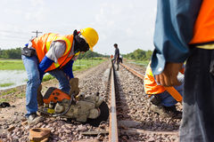 Workers were cutting tracks for maintenance. Stock Image