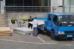 The workers were unloading the building materials from the car Royalty Free Stock Photography