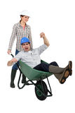 Workers with a wheelbarrow Royalty Free Stock Image