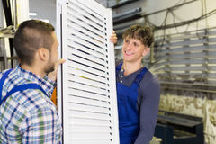 Workers with   window with shutter Stock Image
