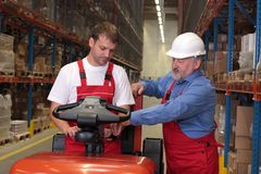 Free Workers With Forklift In Warehouse Royalty Free Stock Photography - 6338097