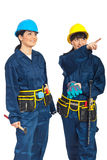 Workers women pointing up Royalty Free Stock Images