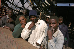 Workers of a wood mill. Black workers of Stevens Lumber Mills in Haenertsburg of Limpopo Province in South Africa after the wood carving mill was burnt to the Royalty Free Stock Photos