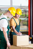 Workers during work in a factory Stock Photography
