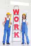 Workers with WORK letters Stock Images