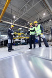 Workers working with aluminium billets Stock Photography