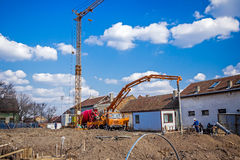 Workers are working on concreting at construction site. Royalty Free Stock Photo