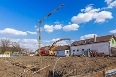 Workers are working on concreting at construction site. Royalty Free Stock Photos
