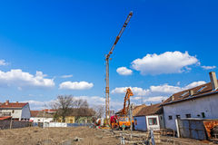 Workers are working on concreting at construction site. Stock Photo