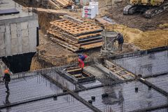 Workers working at a construction site. The group of workers working at a construction site. Top view Stock Images