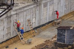 Workers working at a construction site. The group of workers working at a construction site. Top view Stock Image