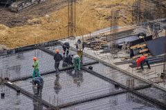 Workers working at a construction site. The group of workers working at a construction site. Top view Royalty Free Stock Photos