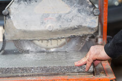 Workers are working, cutting marble cutter Stock Images