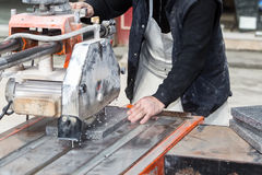 Workers are working, cutting marble cutter Stock Image