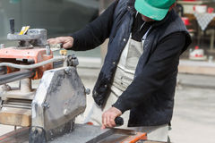 Workers are working, cutting marble cutter Royalty Free Stock Photo