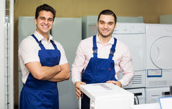 Workers working at household Stock Image