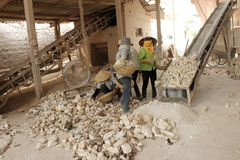 Workers working in lime kiln Royalty Free Stock Photography