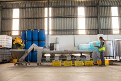 Workers working together near production line. In oil factory Royalty Free Stock Image
