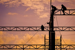 Workers working at twilight Stock Photography