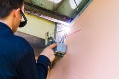 Workers are working by using a welding machine. To strengthen the structure stock photos