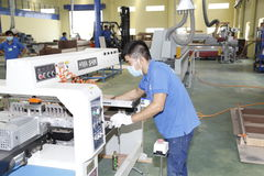 Workers are working in a wood factory for exporting Stock Images