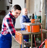 Workers at workshop Royalty Free Stock Photos